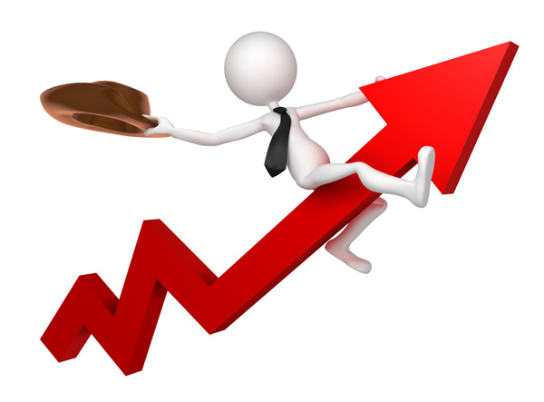 Businessman riding stock market high